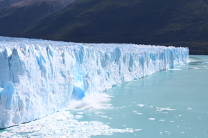 A massive piece of ice calving from the Perito Moreno glacier