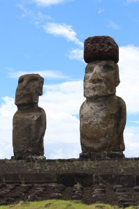 Two Moai, one with a red topknot. Rapa Nui.